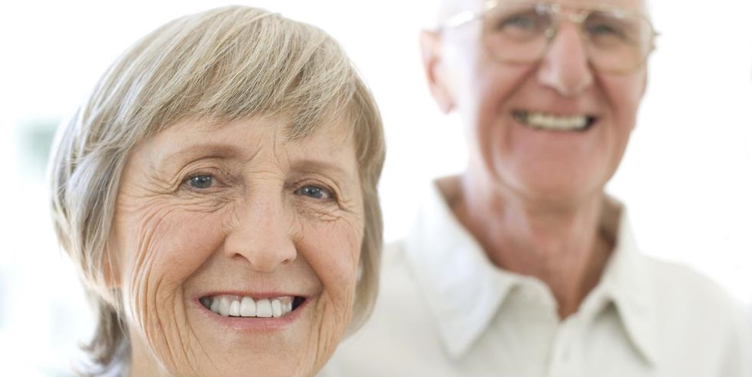 caring for elderly parents. An elderly couple smile