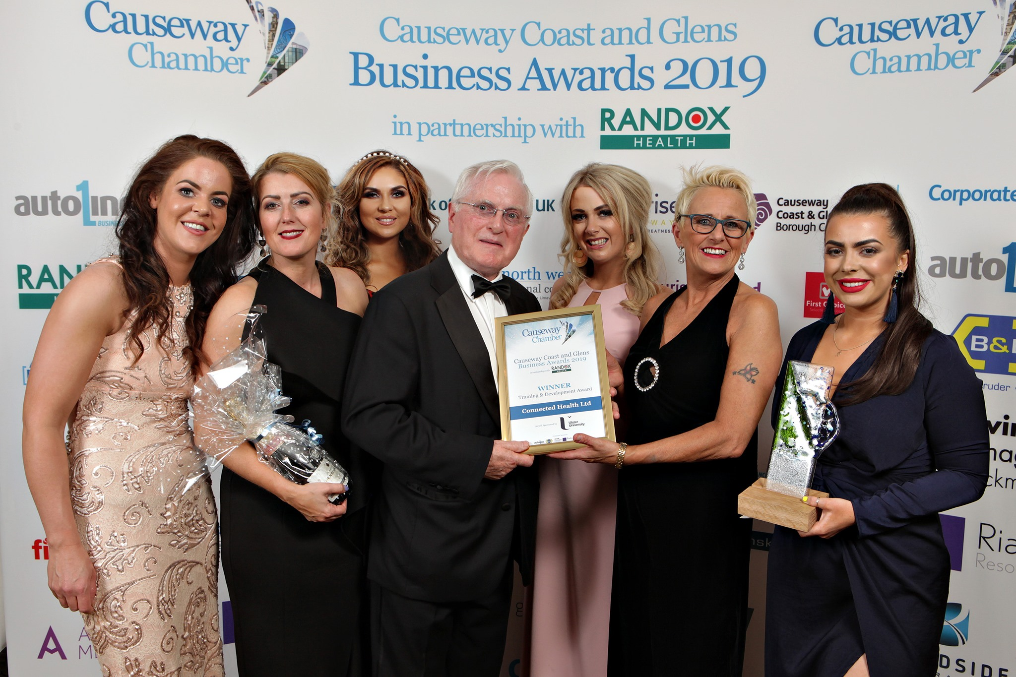 Connected Health staff celebrate winning the Training & Development Award at the recent Causeway Chamber 2019 Causeway Coast and Glens Business Awards